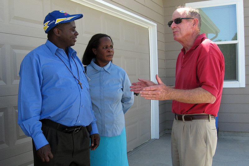 After Pastor John Chisumkha, left, of Malawi, Africa, asks what makes America so prosperous, Marty Wilson, right, explains the concept of free enterprise and small businesses to Chisumkha and Getrude Msowoyo. Three Malawi citizens visited Loveland through the Mountain View Presbyterian Church for three weeks to learn about our way of life.