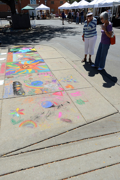 Loveland residents Yvonne Verbel, right, and Pat Horton check out some of artwork on display on the sidewalks as part of Pastels on Fifth on Saturday, Sept. 8, 2012 in downtown Loveland.