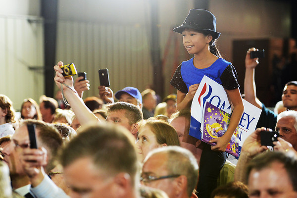 Eleven-year-old Liberty Warner looks over the crowd at Republican vice-presidential candidate Paul Ryan during a campaign rally on Wednesday, Sept. 26, 2012 at Walker Manufacturing in Fort Collins.