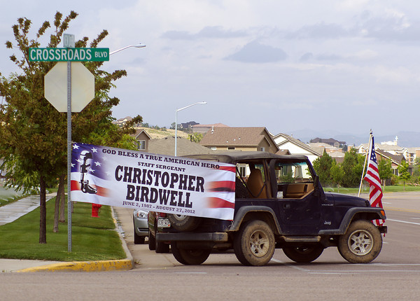 A Jeep displays a banner honoring Staff Sgt. Christopher Birdwell along the procession route Friday near his Windsor home.