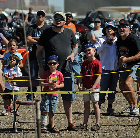 "A crowd gathers to watch as Michelangelo Nock, a member of the Nerveless Nocks, performs on the ""Wheel of Death"" during Thunder of the Rockies on Sunday."
