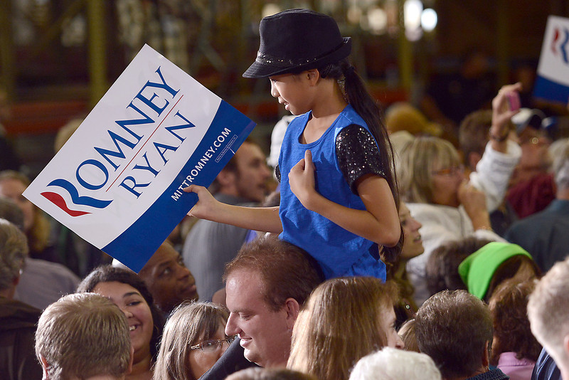 Eleven-year-old Liberty Warner of Casper, Wyo. holds a sign as she looks over the top of the crowd at a campaign rally featuring Republican vice-presidential candidate Paul Ryan on Wednesday, Sept. 26, 2012 at Walker Manufacturing in Fort Collins.
