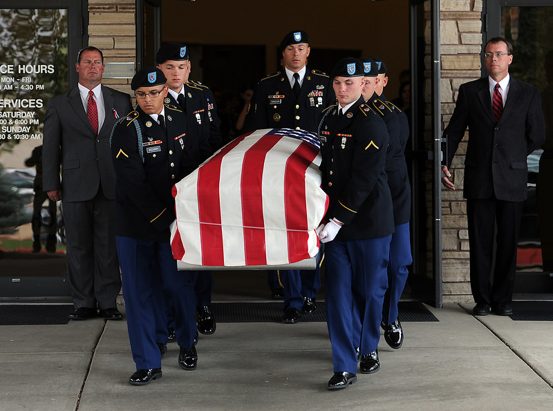 Pallbearers carry Army Staff Sgt. Christopher Birdwell's casket to a hearse Friday after his memorial service at Resurrection Fellowship Church in Loveland.