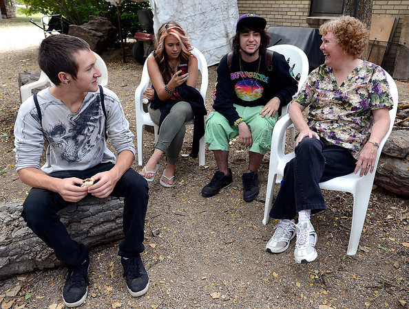 Sherilyn Cook, right, shares a laugh with Mountain View High School students Monday during lunch break at her Loveland home near the school. From left they are Brandon Denton, 16, Jasmine Taylor, 16, and Tristan Floreth, 17.