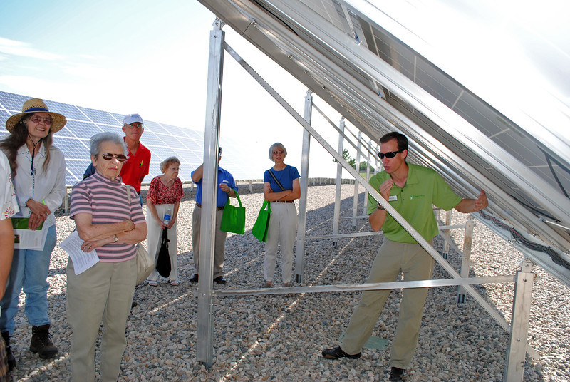 Residents who bought solar panels in the Poudre Valley Rural Electric Association's solar farm learn how the arrays turn sun into power from<br /> Paul Spencer, founder and chief executive officer of Clean Energy Collective, which partnered on the project.