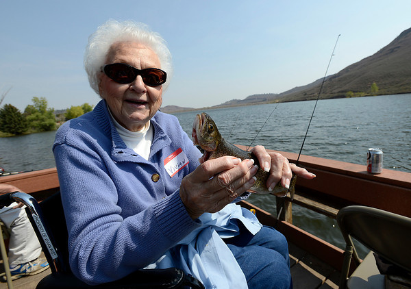 Vivian Wist of Loveland shows off her catch Wednesday during the Loveland Fishing Club Senior Fishing Derby at Flatiron Reservoir.