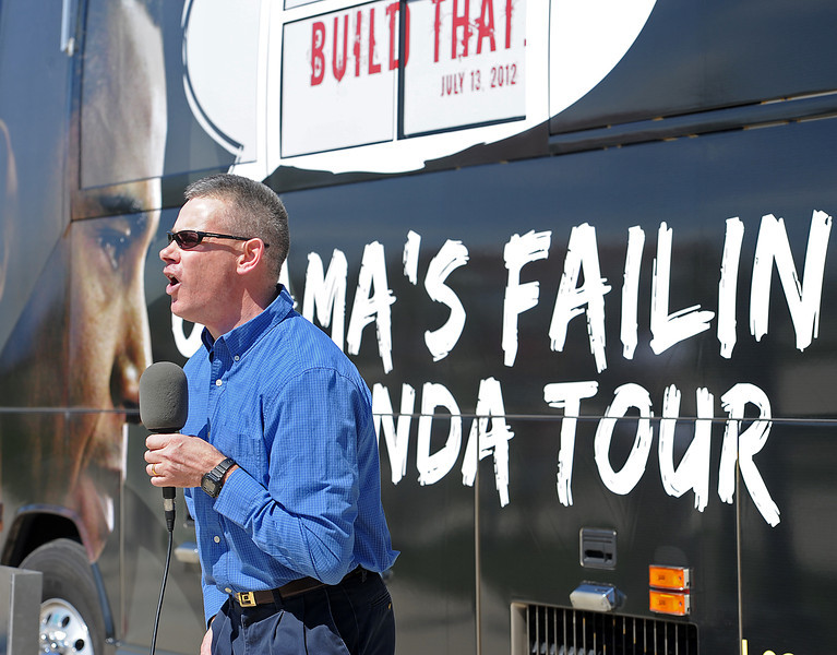 Brian Ivers speaks Monday to folks as part of the Obama's Failing Agenda Bus Tour organized by Americans for Prosperity during a stop at the Loveland Sports Park in Loveland.