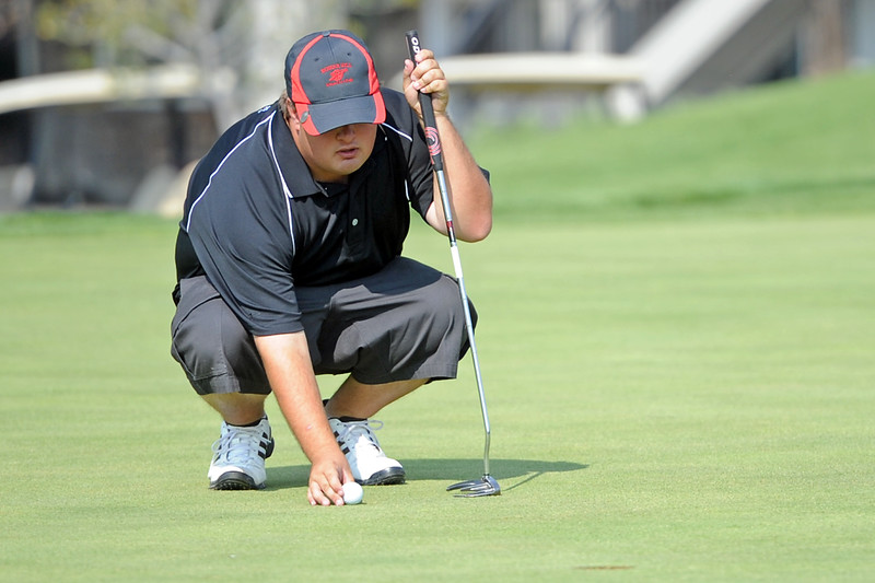 Fort Morgan High School senior Kollin Mobley prepares to putt on No. 18 during the Class 4A Northern Regional Golf tournament on Wednesday, Sept. 19, 2012 at Indian Peaks Golf Course in Lafayette.