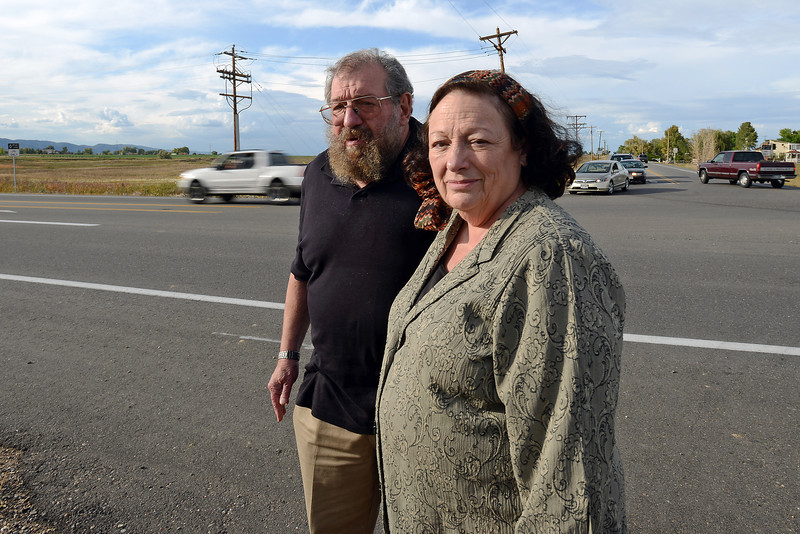 Bernie and Linda Rollin pose together Tuesday, Sept. 25, 2012 at the end of their driveway on East County Road 30 at its intersection with County Road 11 which is the site of a proposed roundabout.