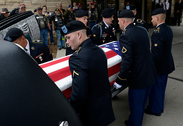 Pallbearers load the casket carrying Army Staff Sgt. Christopher Birdwell's body into a hearse Friday after his memorial service at Resurrection Fellowship Church in Loveland. Staff Sgt. Birdwell was killed in action August 27, 2012, in Afghanistan.