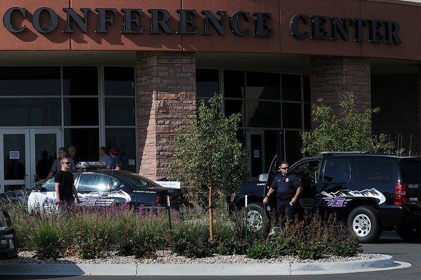 Loveland Police investigate the scene of a shooting Embassy Suites conference center near The Ranch. A witness, who declined to give his name, said a vendor shot himself accidentally during the gun show that was taking place.