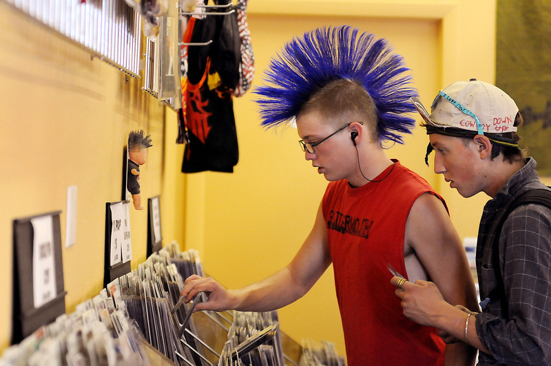 Thomas Kavanaugh, 17, left, and Chris Reidhead, 16, of Fort Collins peruse the punk section of The Finest, a music store that will be closing in October.