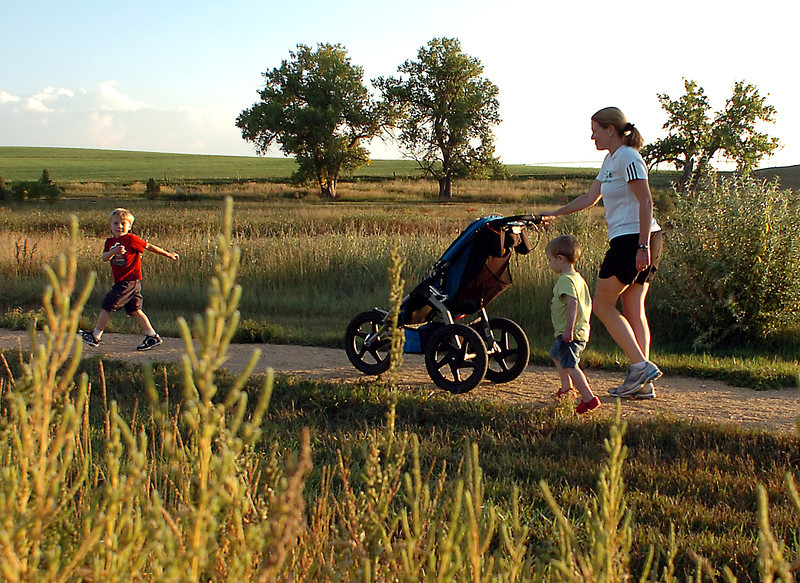 Carlin Barkeen of Berthoud walks with her sons, Gavin 4, left, and Grant, 2, Wednesday evening, Sept. 16, 2009, in Berthoud. Barkeen runs with the Berthoud Run/Walk Club, an exercise group open to anyone in the community.