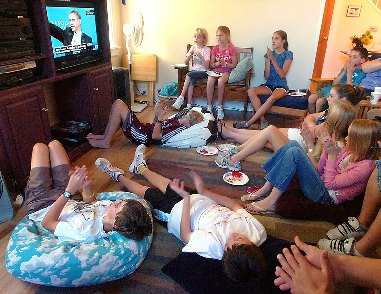 A group of students from Berthoud Elementary School, Turner Middle School and Berthoud High School watch President Obama on television Tuesday morning at Laurie Hindman's Berthoud home.
