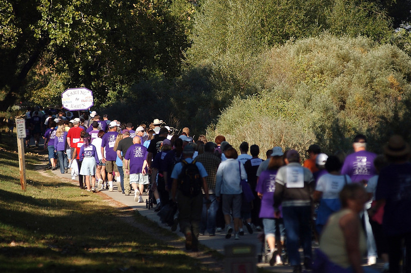Walkers crowd the Recreation Trail near Centennial park on Saturday during the 20th annual Memory Walk. They gathered and walked to and from Wilson Avenue to honor those who have died or suffer from Alzheimer's disease.