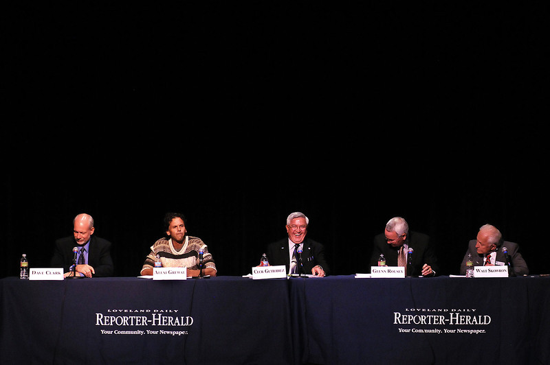 "Cecil Gutierrez, center, reacts after Alexi Grewal, second from left, asks him the question: ""What's a nice guy like you running for a nasty job like this?"" on Monday night during a debate of mayoral candidates at the Rialto Theatre. The candidates, including Dave Clark, left, Glenn Rousey and Walt Skowron were each given a chance to ask a question of one of the other candidates during the debate."