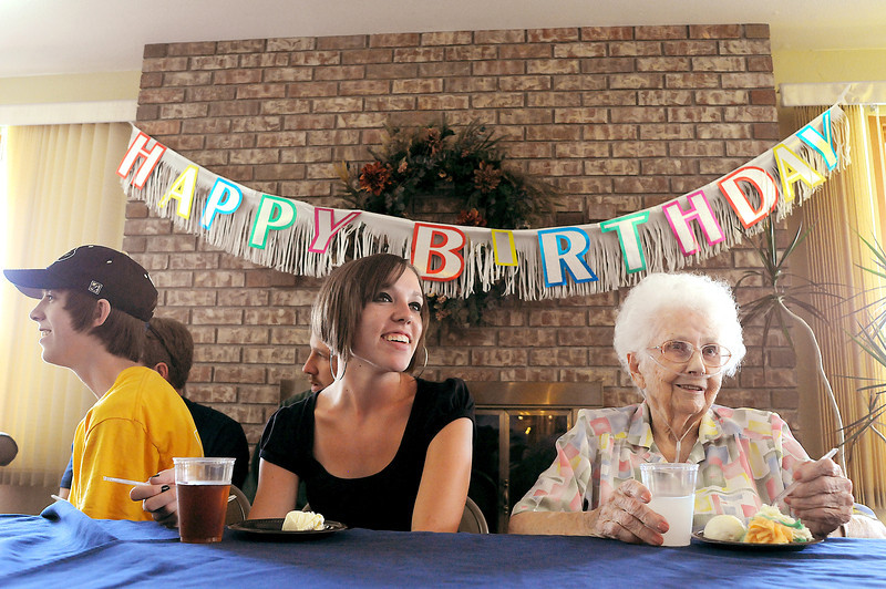 Ruth Bronson right talks with her greatgrandchildren Jason Boynton, 17, out of frame, Taylor Buck, 18, center, and Clayton Buck, 15, as Bronson's family celebrate her 99th birthday on Sunday at the North Shore Health Facility. Her actual birthday is on Sept. 9, 2009, a date auspicious because her 99th birthday falls on a date with so many nines in it.