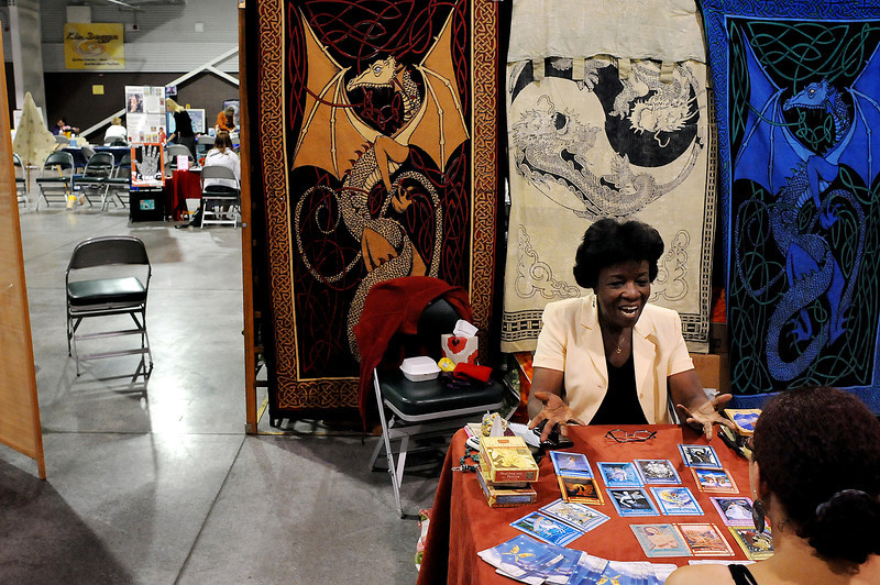 A Denver psychic known only as Jyoti talks with Tasha Shropshire, right, of Fort Collins on Sunday at the Fall Holistic Health Fair at The Ranch. Area fortune tellers, psychics and healers set up booths over the weekend to offer Northern Coloradans alternatives to physical and spiritual healing.