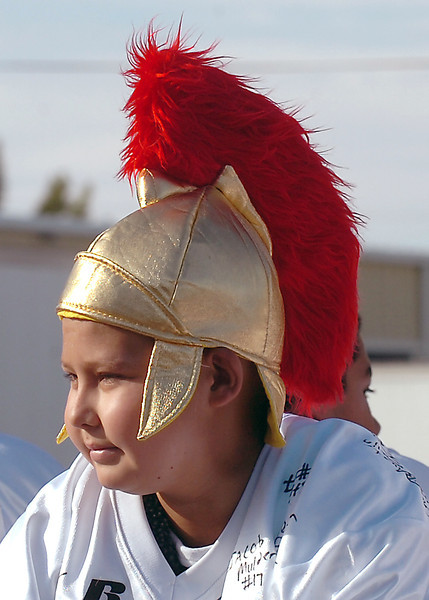 Alex Sabados, 13, a Turner Middle School student, sports a Spartan hat Friday during the Berthoud High School homecoming parade.