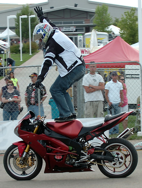 Matt Miller, a stunt rider with Suicidal Lifestyles, shows off a trick for spectators Friday, Sept. 4, 2009, during Thunder in the Rockies at The Ranch in Loveland.