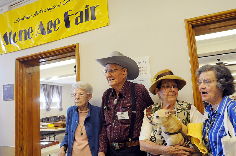 Stone Age Fair participants Margaret Harris, left, of Gill, her brother Ivan Harris, and Ivan's wife Budah, of Pueblo West, holding their dog Two Bow as they pose with Jean Crawford of Loveland on Sunday.