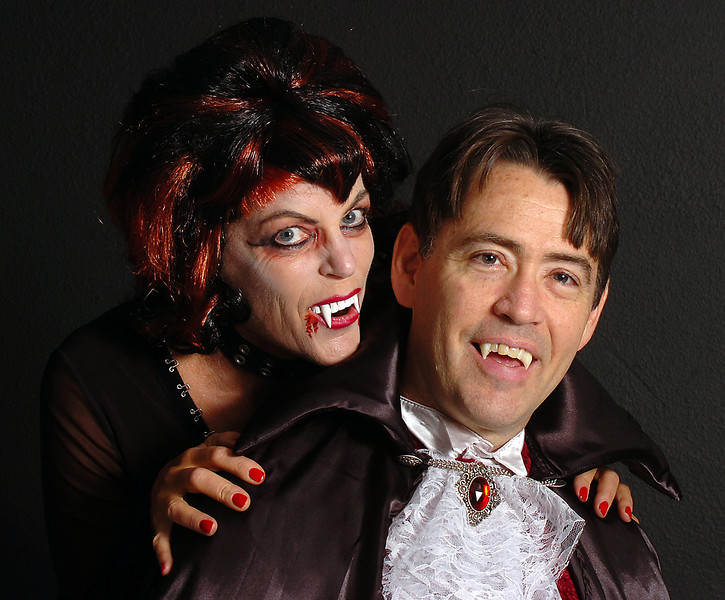 Kathy Reams, left, and Rick Roberts, both members of the Loveland Road Runners, pose for a photo dressed as vampires. The running club is trying to break a world record by gathering the largest number of people dressed as vampires in one place.