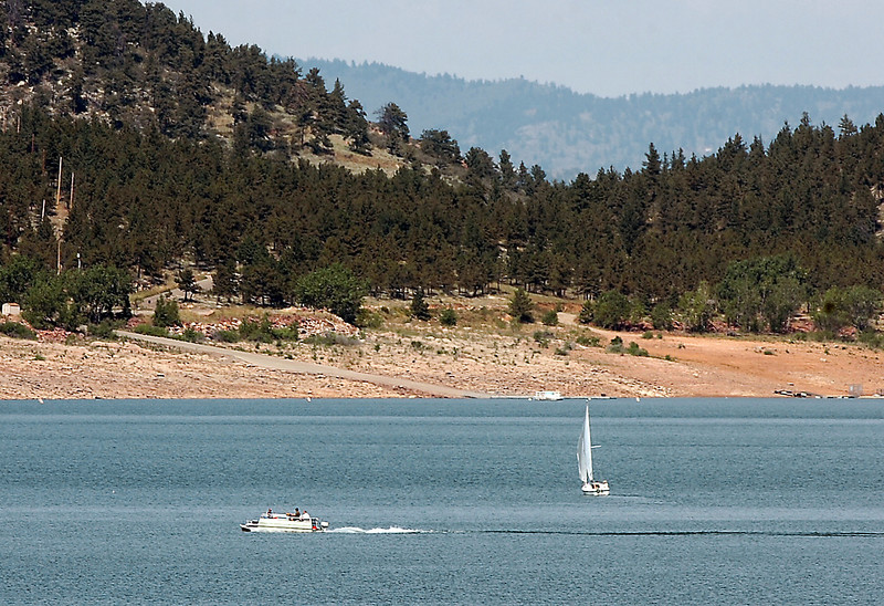 Boaters take advantage of the warm weather and the historic high water levels Tuesday afternoon at Carter Lake. The swim beaches and boat ramps at both Carter Lake and Horsetooth Reservoir will remain open through the end of September.