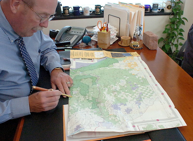Larimer County Sheriff Jim Alderden points Monday to an area on a map where two women were attacked by a man with a knife on Sunday. The women used a walking stick to fight back and escaped.