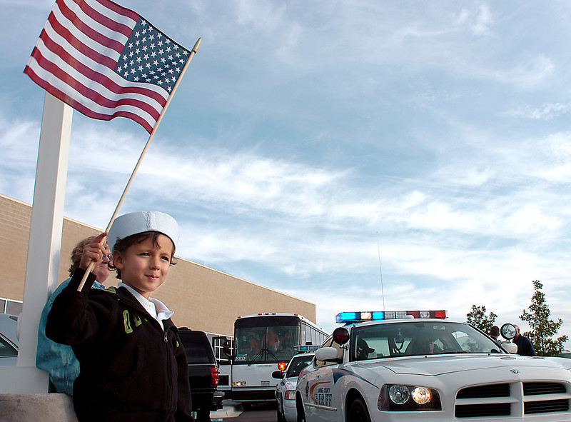 Five-year-old Jonah Speyer of Westminster sports a sailor hat as he prepares to wave goodbye to his great-grandpa, John May, who headed off  Friday morning from the Embassy Suites in Loveland to catch an Honor Flight to Washington, D.C., with other local veterans. May served in the  Navy during World War II and was part of a group being taken to the capital to visit the World War II Memorial and other sites.