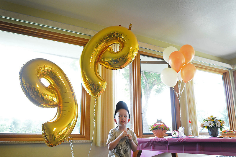 Brayden Buck, 4, boxes with the balloons that commemorate his great grandmother Ruth Bronson's 99th birthday. Brayden Buck's birthday is the day after his great grandmother's.