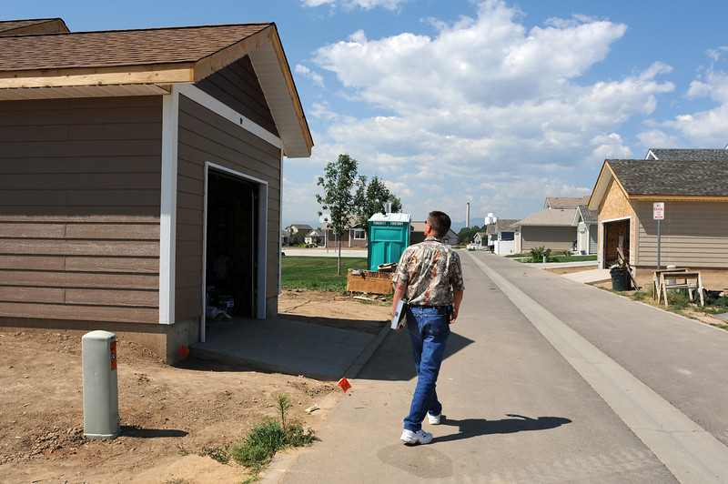 City of Loveland Building Inspector Dave Sprague walks around a home during a preliminary inspection on Wednesday at a Habitat for Humanity home in the 2000 block of Sagittarius Drive in Loveland.