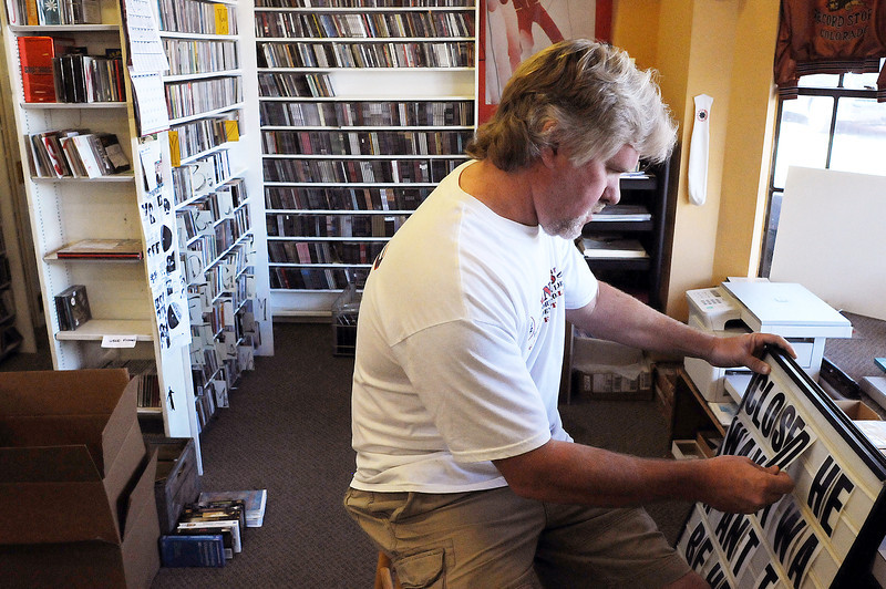 "Jim Risser, owner of The Finest, a Fort Collins music store, puts letters on a sign that will announce the store will be closed for a few days until Oct. Risser will close the store for good at the end of October but he said he feels good about what he did: ""I made a career out of my hobby,"" said Risser who started working at the store in 1981. ""I've never been on a job interview in my life. I'll land on my feet - somehow, someway."""
