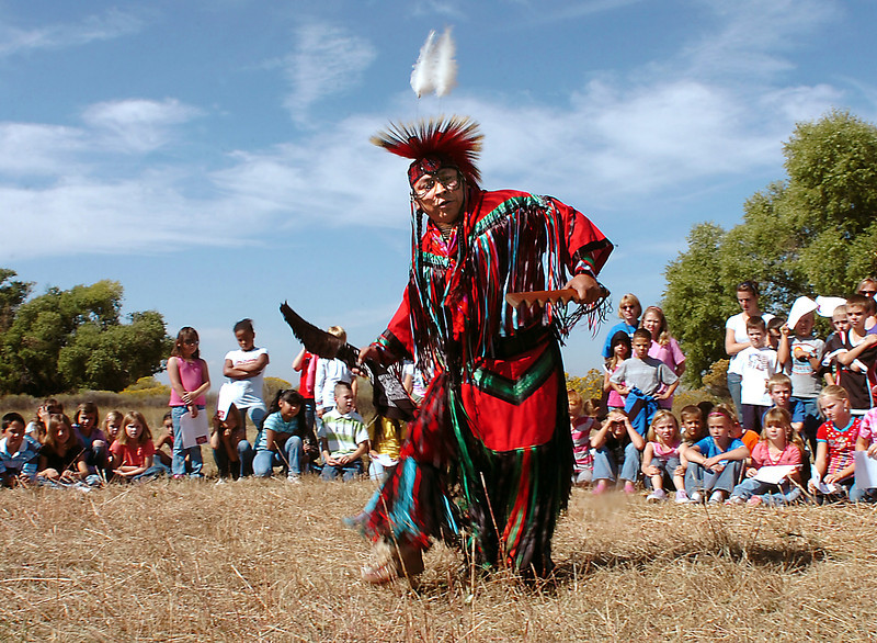 John Gaisthea, dressed in Hopi attire, dances for students from three Loveland schools Friday at the High Plains Environmental Center in east Loveland.