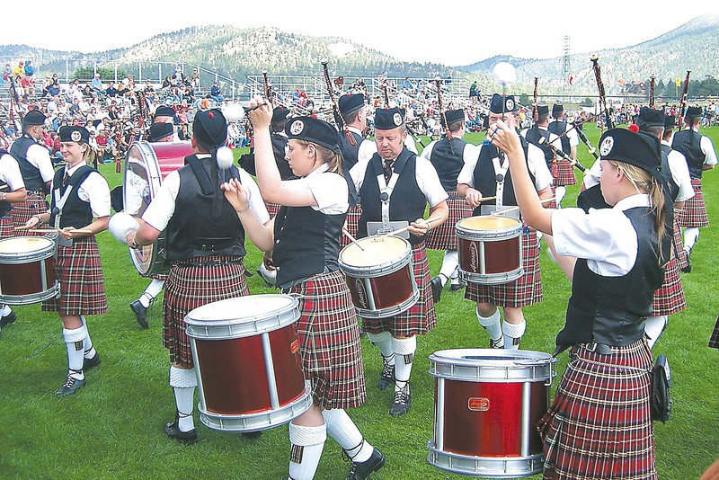 FILE PHOTO: The Lothian and Borders Police Pipe band performs for an audience during the Longs Peak Scottish/Irish Highlands Festival at the fairgrounds in Estes Park.