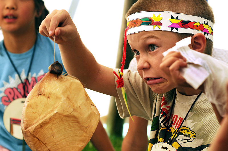 Berthoud Elementary third grader David Kendrick, 8, reacts while holding a buffalo bladder as he and classmates learn how American Indians used all parts of a buffalo during tepee week at the school on Tuesday. The school district purchased new tepees after the original tepees were vandalized while in use at Garfield Elementary earlier in the month.