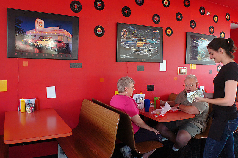 Ruth McConnell, a waitress at Fatso's  Diner,  chats with customers Marsha and Edward Thompson of Loveland on Thursday during lunch at the new diner.