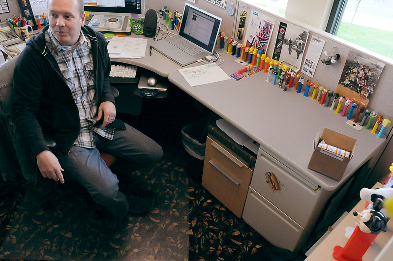 Brand Champion Jeff White works amongst his Pez dispenser collection in his office on Monday at Group Publishing. A fun work environment helps keep turnover low at the 35-year-old company.