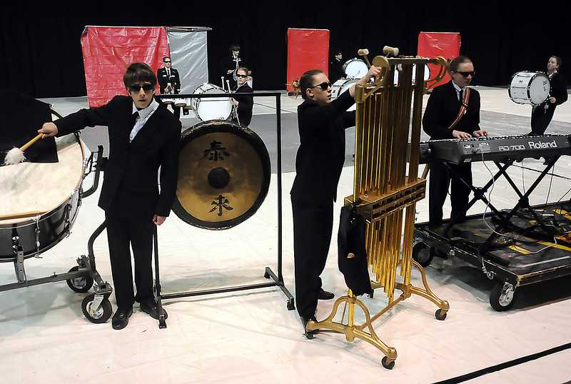 Members of the Thompson Valley High School Indoor Percussion Ensemble, including front from left, Mark Monahan, 15, Kaila Metz, 14, and Tana Barr, 17, perform Saturday during the state drumline competition at the Budweiser Events Center.
