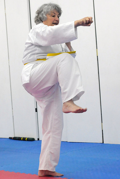 Eileen Van Baren practices an American Kenpo karate move during class Thursday at International Black Belt Academy, 304 E. 5th St. in downtown Loveland.