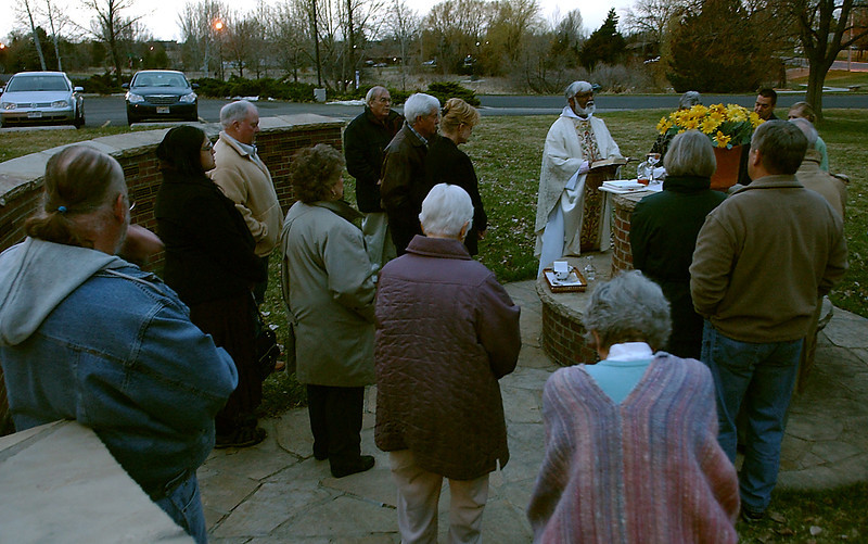 Father Sathi Bunyan leads his congregation in a sunrise service to greet the Easter morning, Sunday.  Here, they are preparing to take communion.