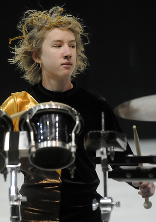 Loveland High School freshman Mark D'Ambrosio, 14, plays along with other members of the school's drum line during the Rocky Mountain Percussion Association Championships on Saturday, April 3, 2010 at the Budweiser Events Center.
