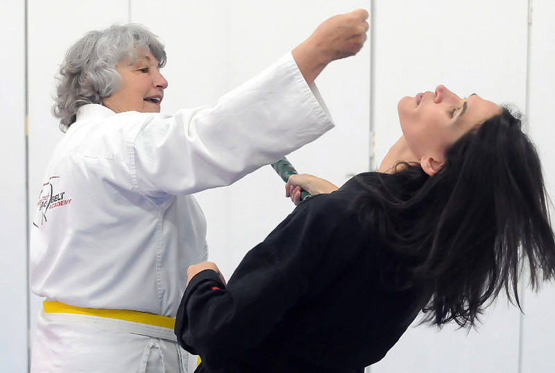 Eileen Van Baren, left, works on a drill with instructor Michelle White during an American Kenpo karate class Thursday at International Black Belt Academy, 304 E. 5th St. in downtown Loveland.