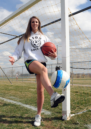 Mountain View High School multi-sport athlete Erin Stumbaugh poses Wednesday on the soccer field outside the school. Stumbaugh wanted to promote attendance at high school sports and has recently started distributing free tickets to seniors.