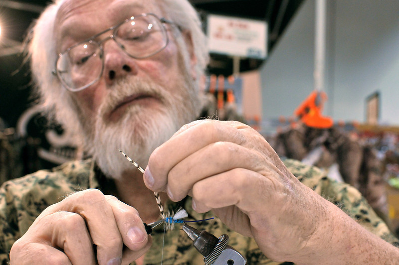 Terry Gibson creates and sells his own flies for fly fishing, SUnday, during the Larimer County Fishing Expo.  Gisbon says he's been making them for over thirty years and you can find them at Bob's Fly Shop.