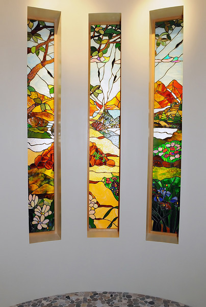 Stained glass windows are a prominant feature at the front of the new chapel at McKee Medical Center.