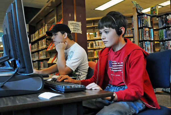 Trenton Rice, 11, right, and Dillon Leno, 17, work on the computers Friday afternoon in the teen section of the Loveland Public Library. The library's expansion will include a new enclosed area for teens with more computers and study rooms.