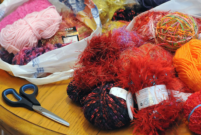 Ginny Crawford and Mary Anne Ellison use a variety of colorful yarns to make scarves that they then sell to raise money for charities.