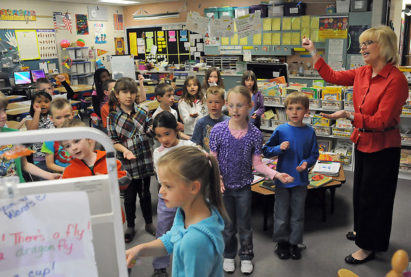 Namaqua Elementary School first grade teacher Bonnie Rowland sings and dances along with her students as they recite a poem together during a literacy lesson Thursday.