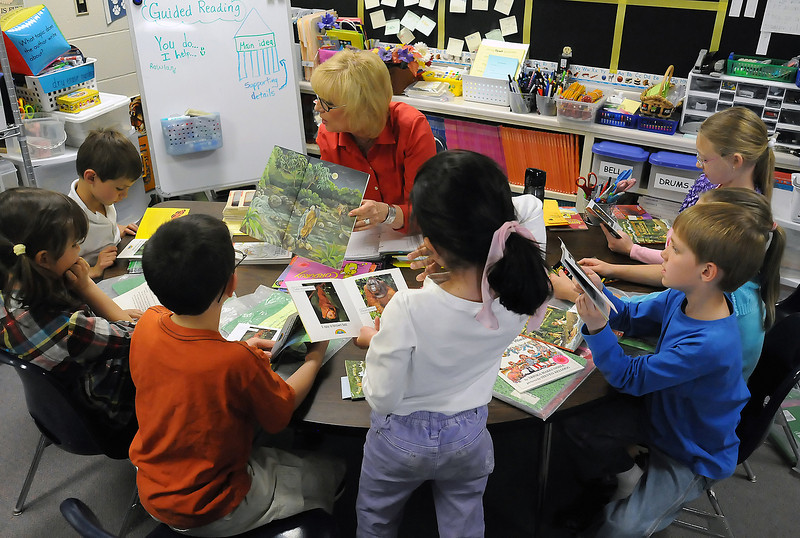 Namaqua Elementary School teacher Bonnie Rowland works with a group of her first graders on a reading exercise during a literacy lesson Thursday at the school. Front from left are Kaidan St. Louis, Nessie Garrey, Michael Cheuvront, Autumn Zhou, Ryan Sederholm, Abbie McCrimmon and Kalani Hayden.