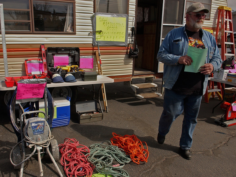 Perry Valcore and his wife Barbara Valcore, not pictured, spent Sunday in an empty lot off Lincoln selling Perry's old tools.  The Ft. Collins veteran could be staring down some serious surgeries in the near future and decided to sell his stuff, donating the money to the American Legion, instead of sticking it in storage.